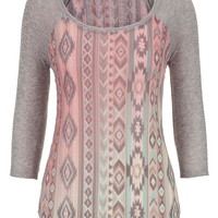 knit top with open stitching in ethnic print