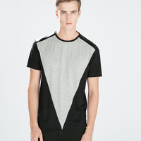 T-shirt with synthetic leather triangle