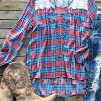 Our Empty Spaces Tunic Top has the right amount of lace for fall! It's a long sleeve plaid tunic top. Scoop neckline with button detail. Lace accents the neckline and top of the back. Made to be loose fitted.