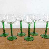 Six green stemmed hock wine glasses, or Rhine wine glasses made in France, 5 ounce capacity