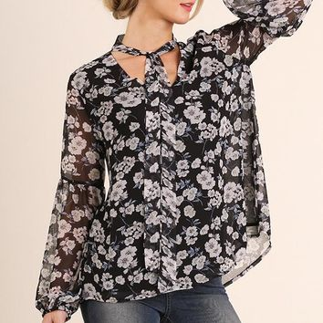 floral print blouse with a neck tie detail