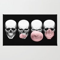 Skulls chewing bubblegum Rug by Piotr Burdan