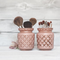 Pink quilted pen or makeup and brush organizer jars.
