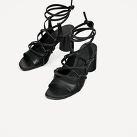 LEATHER STRAPPY HEELED SANDALS DETAILS