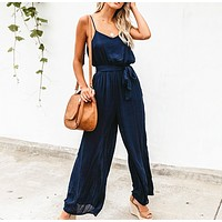 Summer new loose solid color casual sexy suspender wide leg jumpsuit