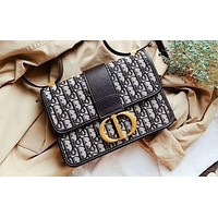 DIOR sells casual ladies woven canvas jacquard logo single shoulder bag with gold button, slanting across bag