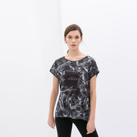 PRINTED T-SHIRT WITH FAUX LEATHER COLLAR