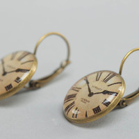 Handmade round earrings with metal basis and image of clocks in glass glaze