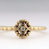 Delicate Renaissance 14K Yellow Gold ring featuring small Diamond accent.