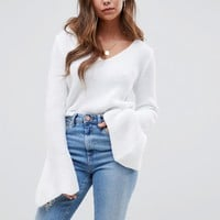 ASOS DESIGN v neck crop sweater with flared sleeve at asos.com