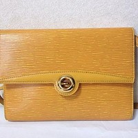 Tagre™ Vintage Louis Vuitton rare yellow epi shoulder purse with gold tone turn lock closure.
