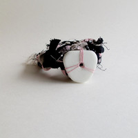 Hand knotted textile bracelet in pink, gray, black and white t-shirt cording with white glass bead accent Spring fashion An Astrid Endeavor
