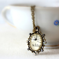 Sing sheet music necklace in filigree setting with rhinstones on toggle clasp chain. vintage style jewelry for singer, musician