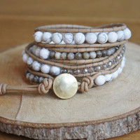 Wrap bracelet with white Howlite beads, silver leaf jasper beads and crystals using leather cord and a golden button and adjustable loops