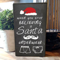 "Wood box sign that looks like chalkboard art ""When you stop believing in santa you get underwear - Approx. 6""x10""x2"""