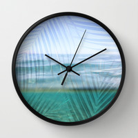 Palms over water  Wall Clock by Sunkissed Laughter