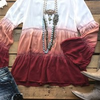 Our Wide Open Spaces Top is a must have! It's a bell sleeve tunic top with lace detail to the sleeves as well as the mid-section from front to back. Has dip dye effect and scoop neckline. We recommend wearing a cami underneath for coverage.