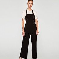 JUMPSUIT WITH RIBBON AND BUCKLES