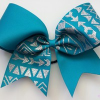 Teal ribbon tribal print cheer bow with silver glitter.