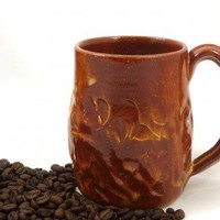 Golden brown cozy wheel thrown mug with hand carved designed stoneware