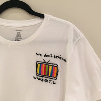 We Don't Believe Whats's On T.V Embroidered T-Shirt