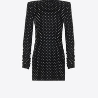 Mini dress with a turtleneck and square shoulders in black velvet