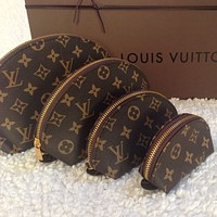 LV Louis Vuitton four-piece cosmetic bag clutch with color printing letters