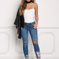 Medium Denim Mid Rise Distressed Skinny Jeans