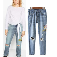 Worn flowers embroidered jeans women