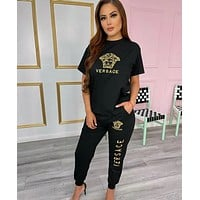 Versace Women With short sleeves Top trousers Two-Piece