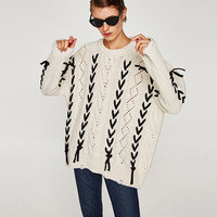 KNIT SWEATER WITH CORDS