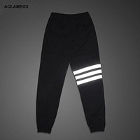 Aolamegs Men's jogger pants night reflective stripe pants joggers outdoors sweatpants street hip hop skateboard dance trousers