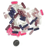 Valentines day mix of glitter caps, glitter pills, crafting supplies, party decor