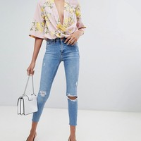 River Island molly distressed raw edge skinny jeans in mid wash at asos.com