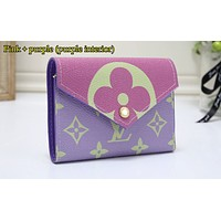 LV sells ladies'wallets and keybags full of color bumps Pink + purple (purple interior)