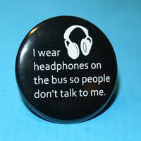 I wear headphones on the bus so people don't by BayleafButtons