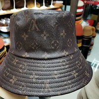 Louis Vuitton (Louis Vuitton) LV fisherman hat men and women the same old flower leather leather stitched rabbit fur basin hat versatile warm classic hat