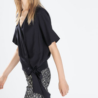Crossover top with side tie