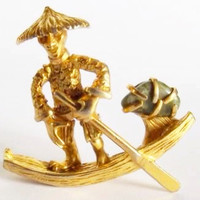 Asian Man in canoe Brooch . Gold Tone. Signed BSK.