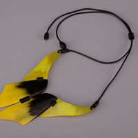 Author's necklet made of a cow horn