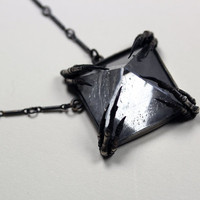 the mini crystal tomb necklace.