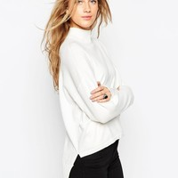 ASOS   ASOS High Neck Sweater with Extreme Stepped Hem and Side Splits at ASOS