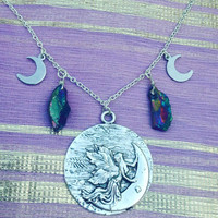The Fairy Ring Necklace - Silver Fairy on a Crescent Moon Pendant with Wire Wrapped Rainbow Titanium Quartz
