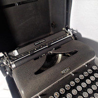 Royal Quiet De Luxe Manual Portable Typewriter, Glass Keys, Chrome Band , Crinkle Finish textured metal, hard board leather look case
