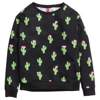 H&M Sweatshirt with Printed Design $9.95