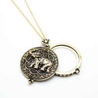 Elephant magnifying glass necklace