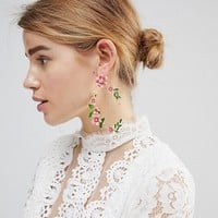 ASOS DESIGN statement floral garden drop earrings at asos.com