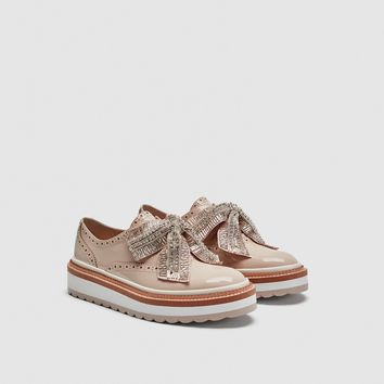 TRACK SOLE BROGUES WITH BOW DETAILS