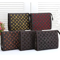 Louis Vuitton LV Fashion New Men's and Women's Embroidered Letter Cross Bag Cosmetic Bag