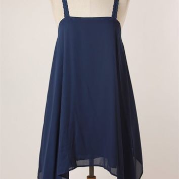 Chiffon tunic featuring round neck, slip on style, navy color crochet lace shoulder straps, sleeveless, draped side design with asymmetrical hem and fully lined.